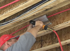 WarmmFloors Q-Panel stapled to floor joist